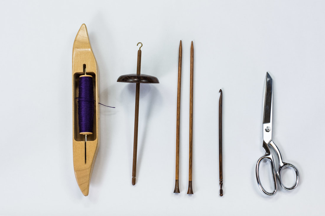 Shuttle, spindle, knitting needles, crochet hook, and scissors. From thefibersprite.